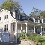 White house with big porch | Cardoso Electrical Services