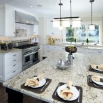 White kitchen with granite counter | Cardoso Electrical Services